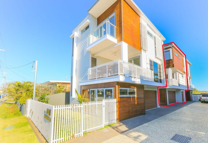 Brand new three bedroom townhouse a short walk from the beach.