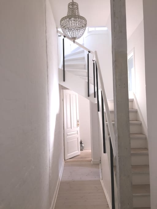Stairs to roof terrace and hall to bedroom.