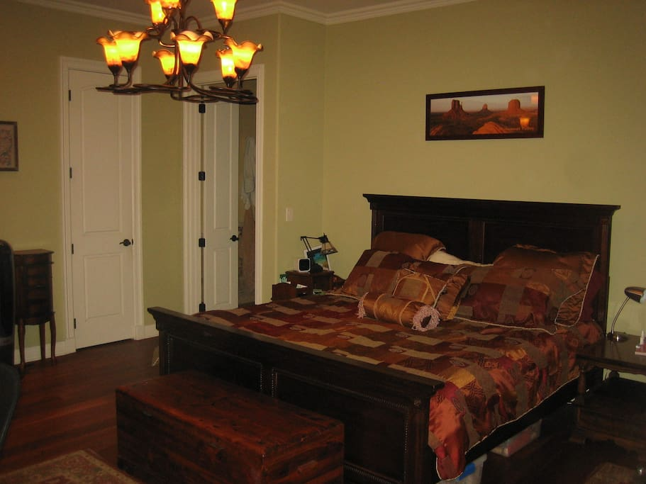 Downstairs Master bed with French doors to deck