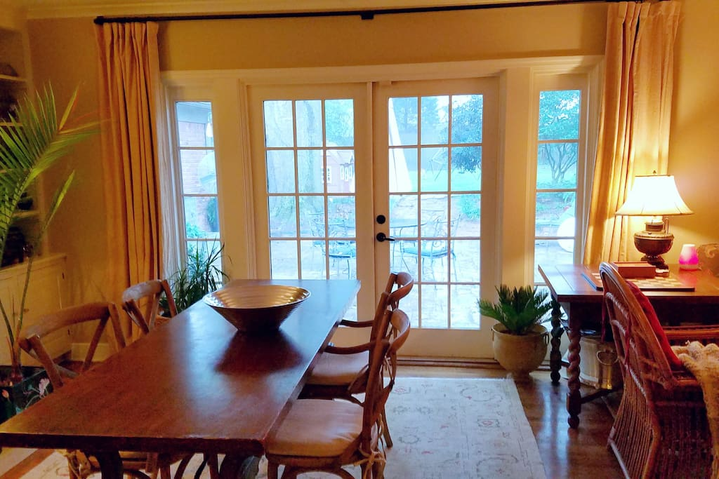 Dining room with French doors to patio. Table seats six.