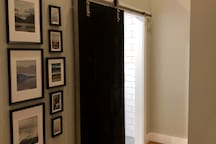 Custom built barn door for bathroom entrance.