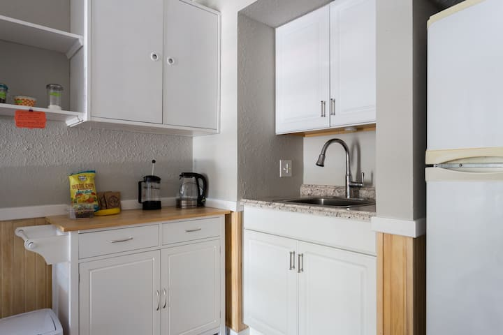 Kitchenette with full size refrigerator and coffee maker.