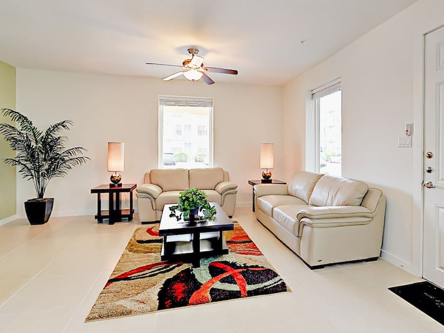 The living room features a love seat and sofa that converts to a sleeper sofa.