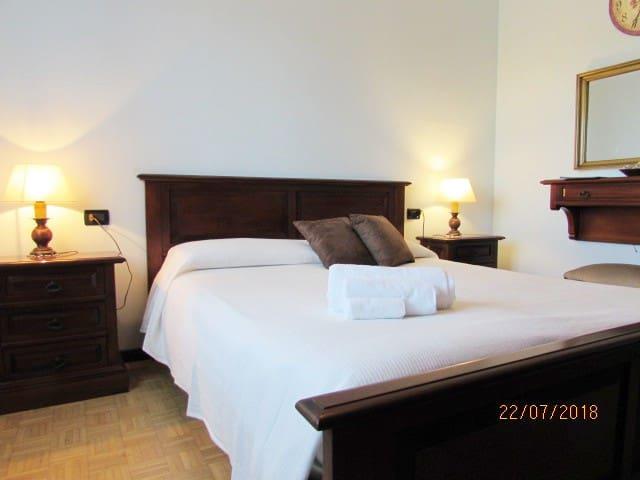 Una confotevole camera da letto