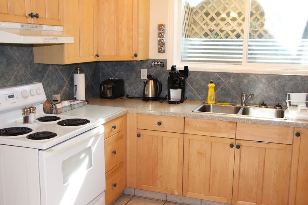 Another view of kitchen with Keurig machine, toaster, kettle & some coffee/tea/oatmeal.
