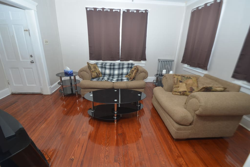 comfy couches, blackout curtains, large screen tv