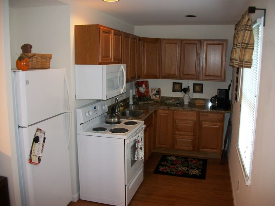 Full kitchen.  Microwave, Refrigerator, Stove/Oven, Sink, Dishes, Pots, Pans, Coffeemaker.