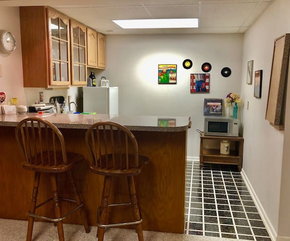Kitchen alcove with counter & stools