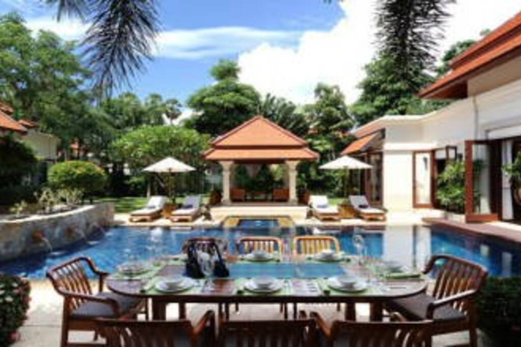 View over the pool and the Sala from the outdoor dining table