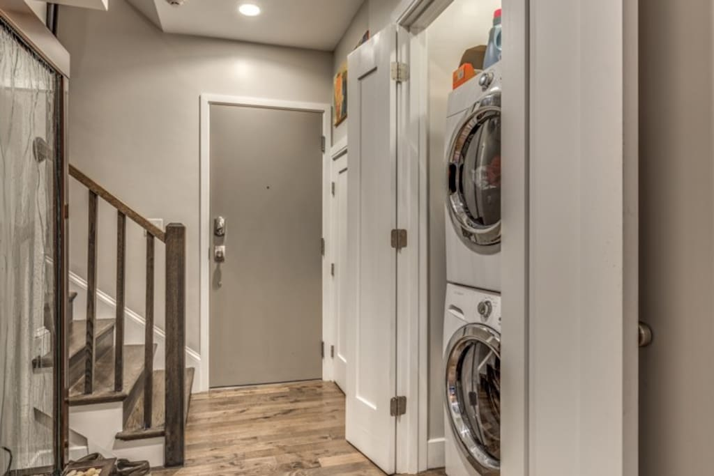 The only thing between the room and the entry door, conveniently is the laundry.