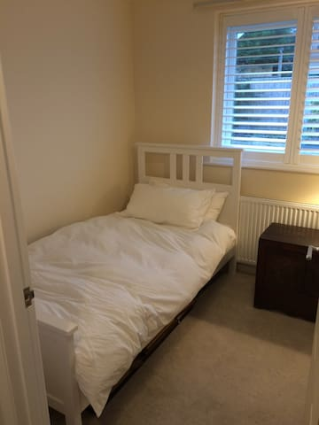 A single bed in twin bedroom