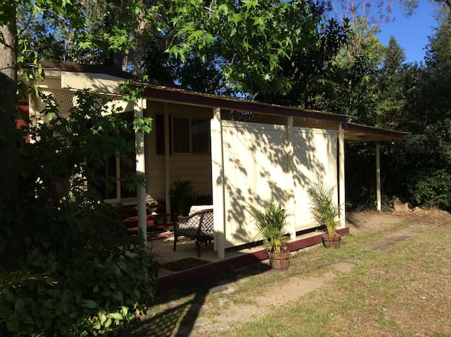 View showing cabin and carport. The cabin is located at the very front of our property, so guests have total privacy as they come and go.
