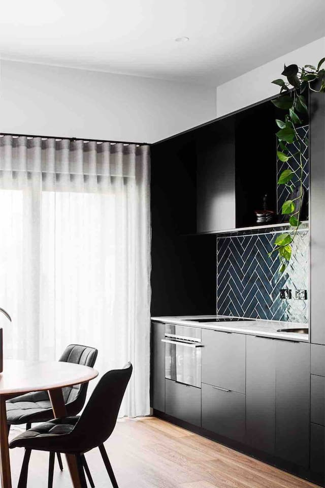 This ground floor apartment is luxuriously appointed. Kitchenette with induction cooktop, combo oven, dishwasher and quality appliances including Nespresso machine. Photo by Angie B.