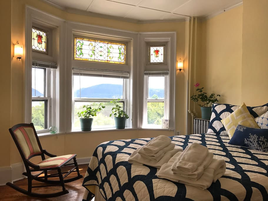 Sunlit bedroom with spectacular views of the Hudson, Storm King Mountain, Bannerman's Island and Breakneck Ridge