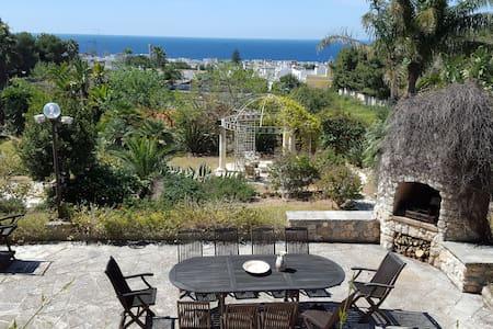 Vista mare in giardino rigoglioso - Lägenhet