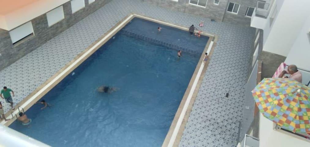 Appartement avec piscine  à une min de la plage
