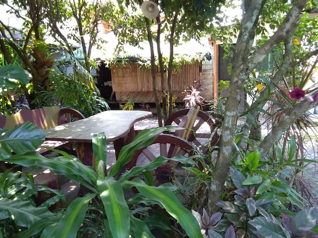 The Brown Bamboo house with the Garden Table