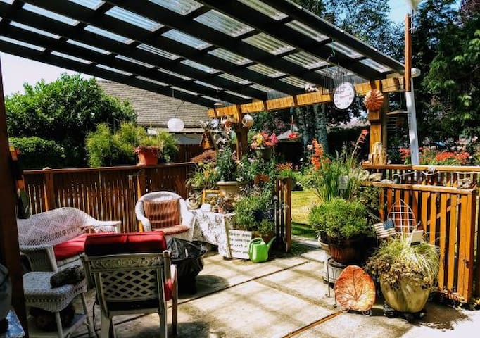 The quiet, covered back deck is a good place to have a barbeque, sit around the fire pit, talk, read...relax!