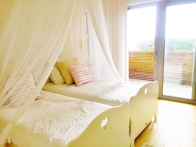 Two single beds in bedroom 2 (upstairs) leading onto shared balcony with sea view. Ideal for children.