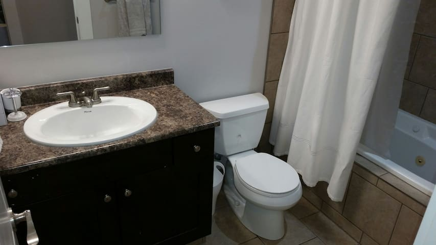 Across the hall from your bedroom is a 4-piece bathroom with jetted tub and heated tile floor.