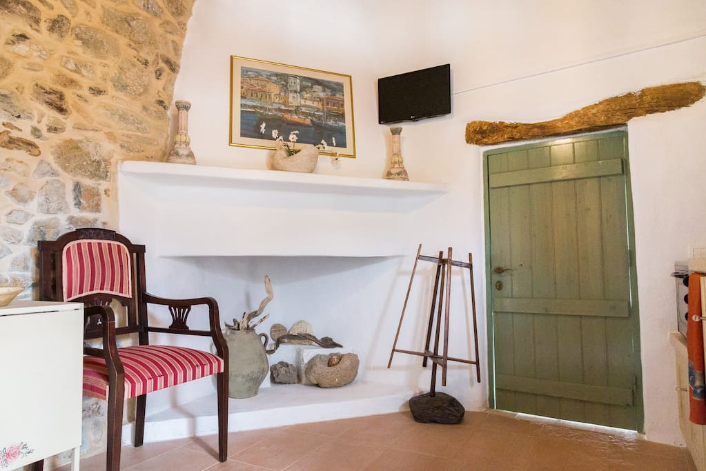 Traditional fireplace and private entrance