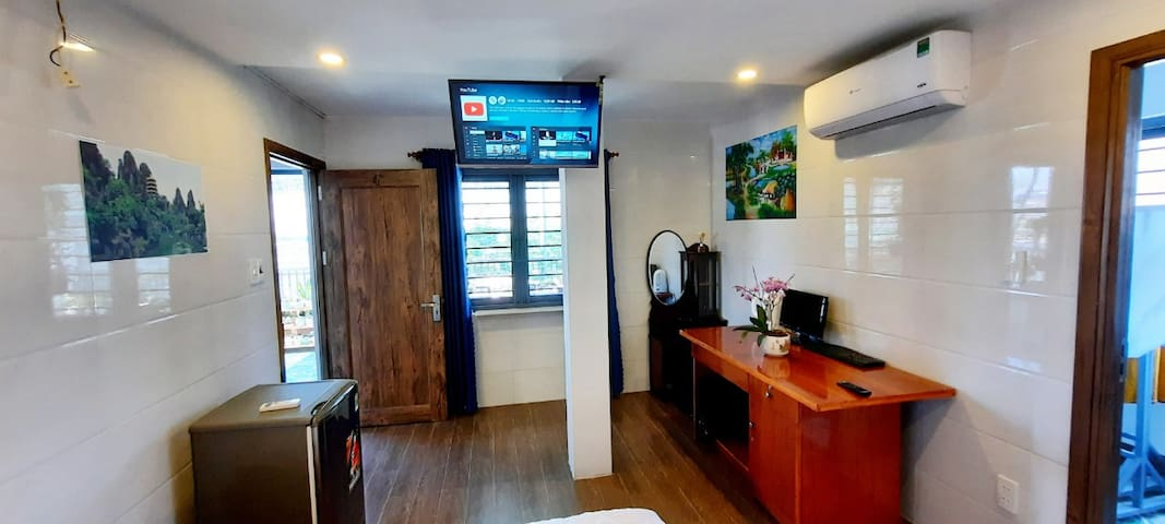 The room with  air-conditioner, 40' flat screen TV, private bathroom, fridge,..& the terrace overwing Danang Han river & Dragon bridge