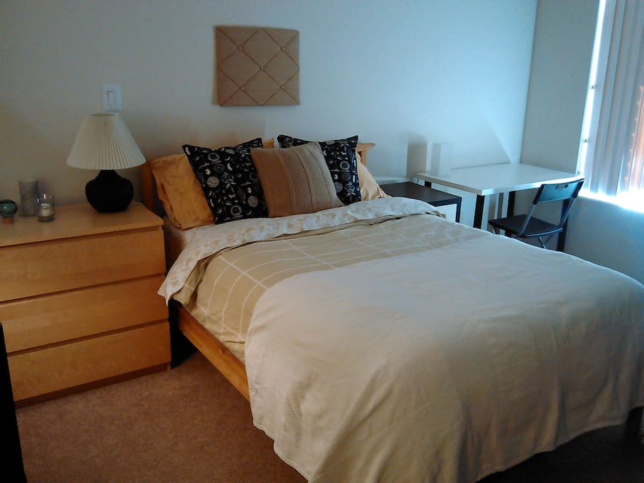 Guest Bedroom with full size bed, desk, and chair.