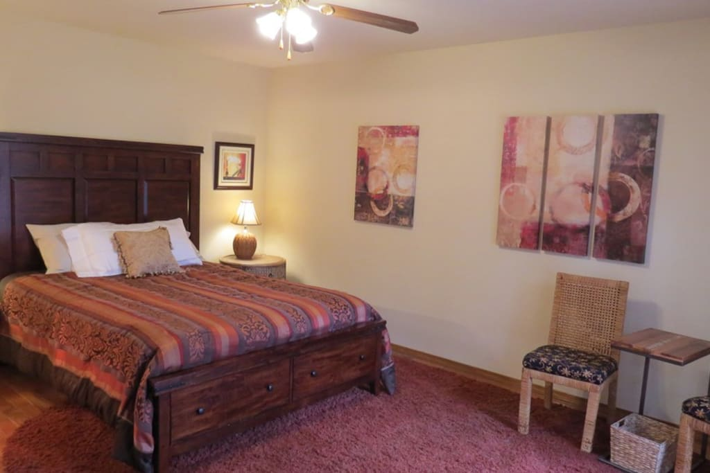 The Island Room is the very spacious master bedroom with an en suite bathroom and a mango wood queen bed.