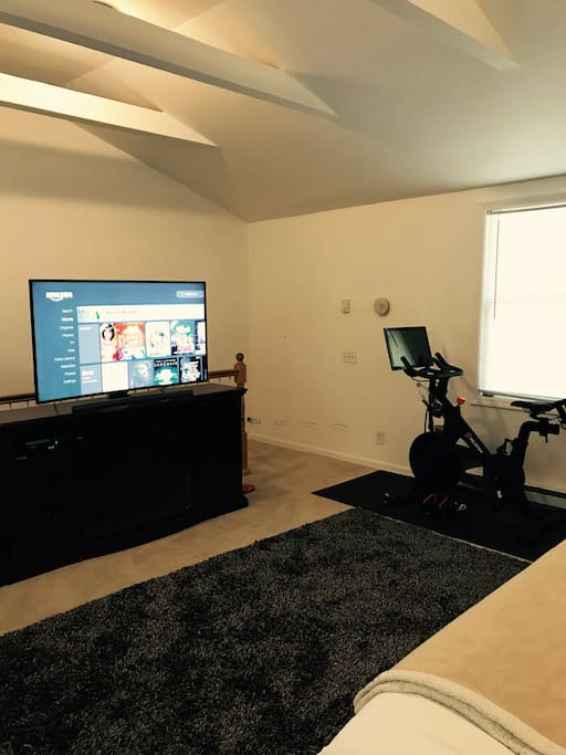 """55"""" curved 4K Samsung smart Television and Peloton."""