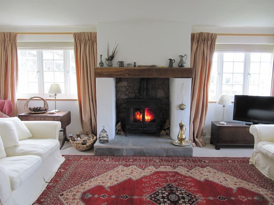 living room with views all round to the fells and woodburner