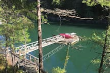 Treehouse private dock with 2 canoes for guests to use May 15- Sept 30 only !