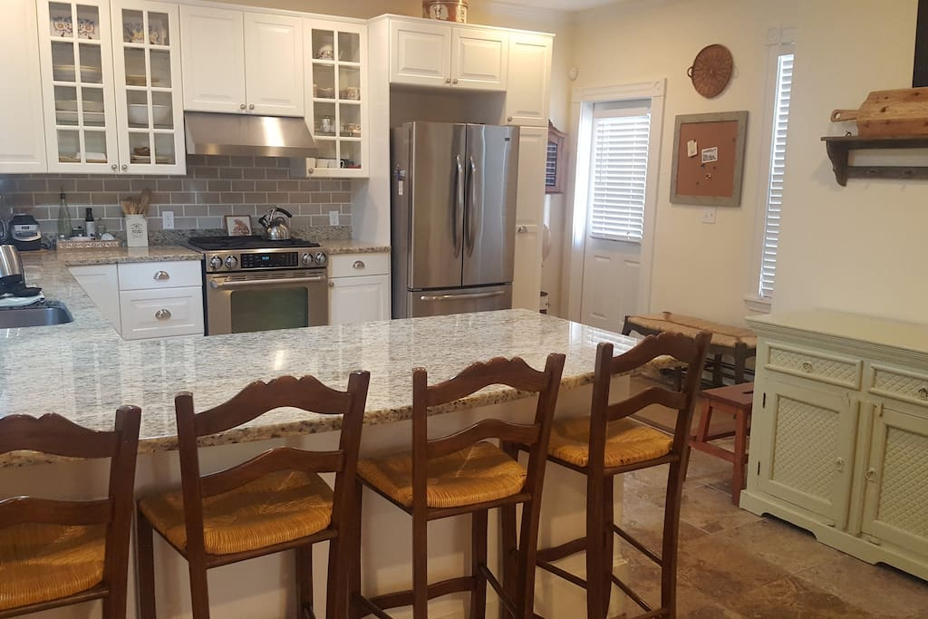 Beautiful kitchen with stools for dining
