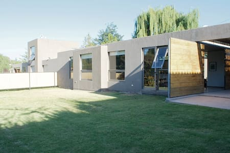 Modern house in Chacras de Coria by vineyards