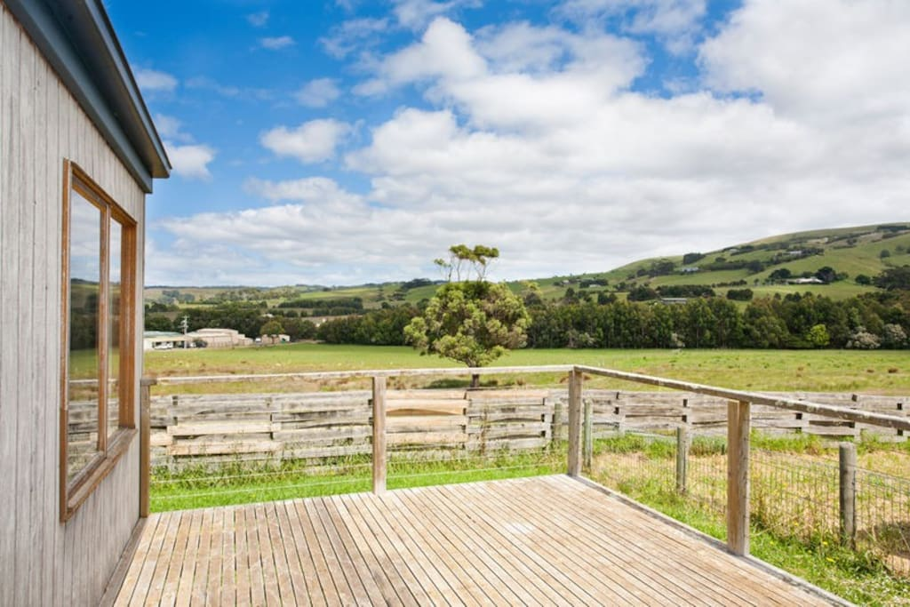decking overlooking the river flats and rolling hills