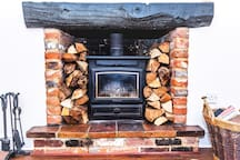 Lovely wood burner stocked with wood