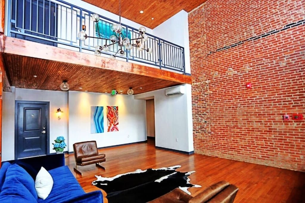 Beautiful rustic Common area in lobby upon entrance of building with exposed brick. Great for meeting neighbors, or hanging with friends