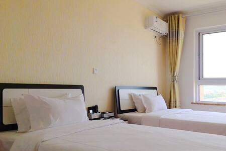 拜登观邸度假公寓(烟台海逸国际店)高级园景双床房 - Yantai - Lakás