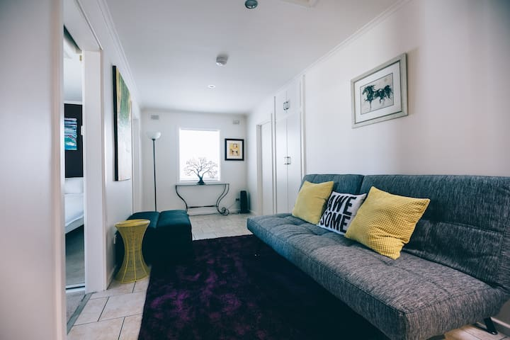 2nd lounge/retreat for teenagers.  The big grey couch folds down into a double bed.  The grey ottoman folds out into a single bed.  Linen supplied as required