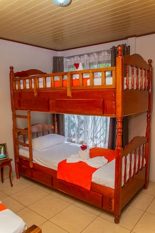 Second bedroom with 1 bunk bed plus 1 single bed and A/C.