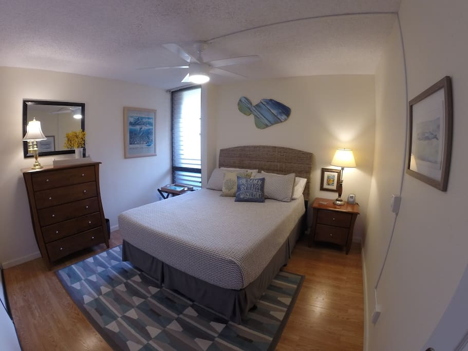 The bedroom - calming colors, original Maui art, queen-size comfy bed. We know you're here for all that Maui has to offer, but it's nice to have a comfortable place to relax after all your adventures!