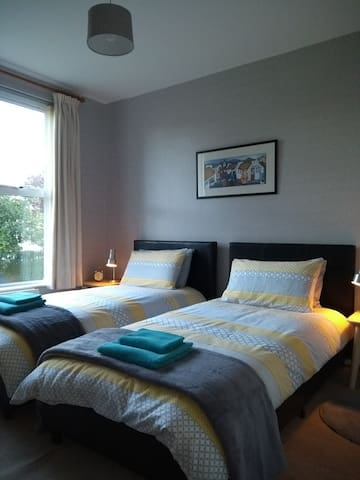 Bedroom 2, modern and bright with large window overlooking garden