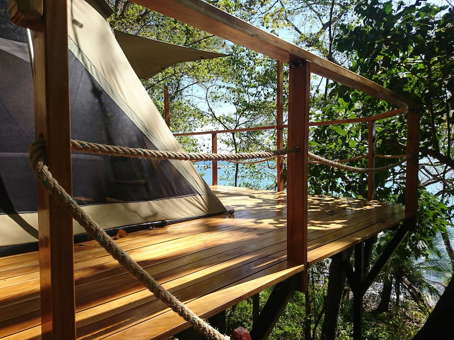 Spacious furnished glamping tents on beautiful wooden platforms.