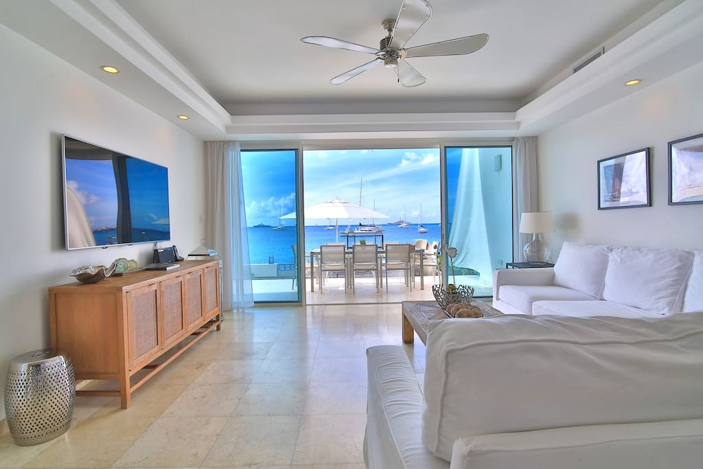 Living room opening to beach side terrace & deck