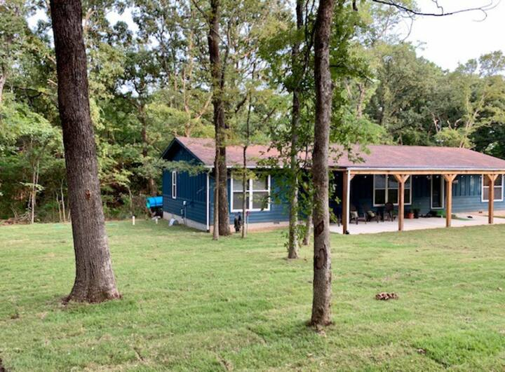 Cozy home tucked away on 5 acres of wooded area!