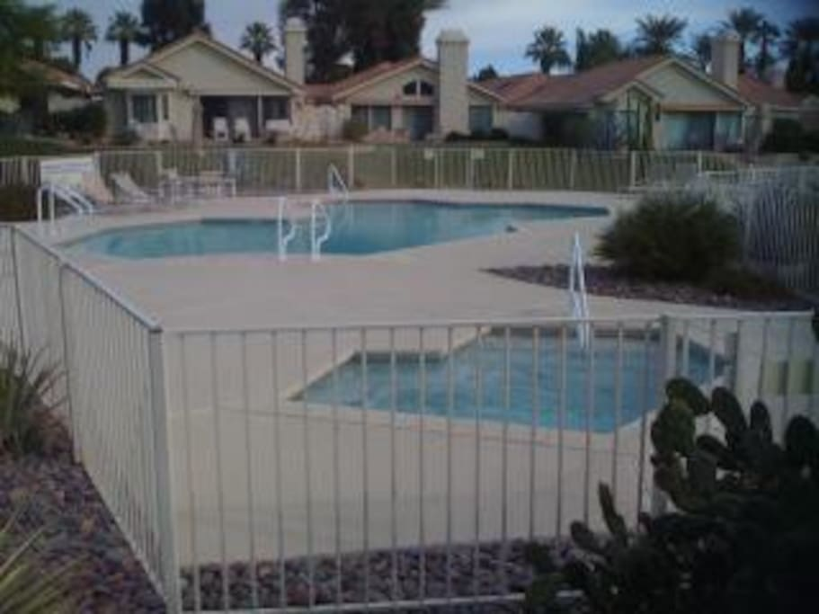 Shared pool and jacuzzi nearby.