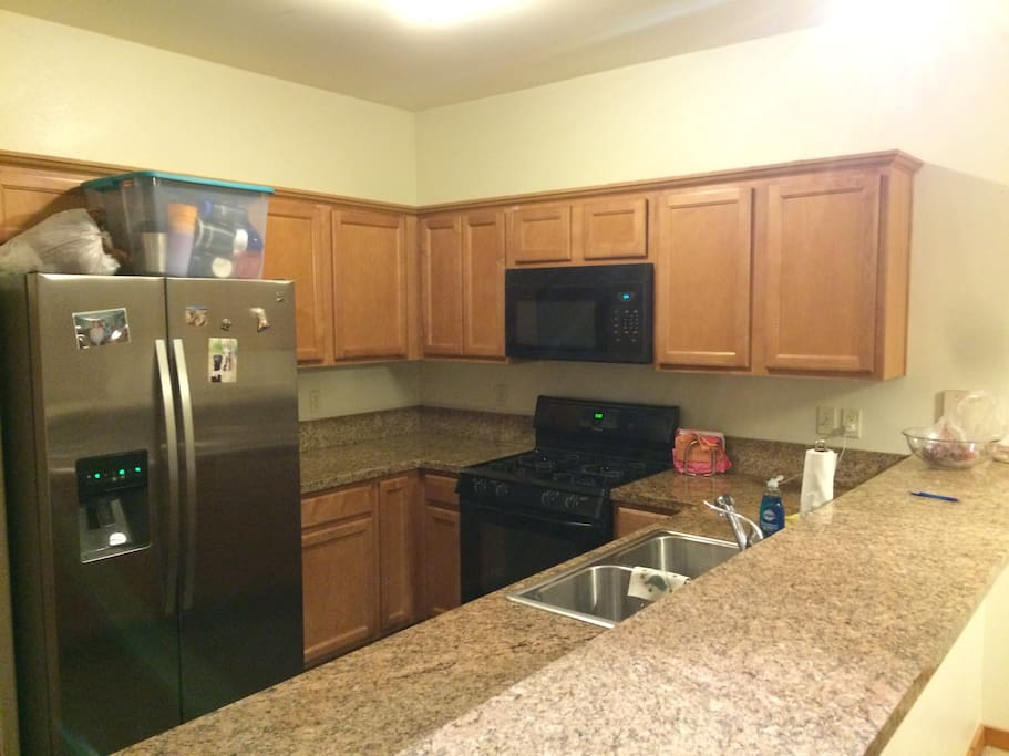 kitchen with gas stove and microwave