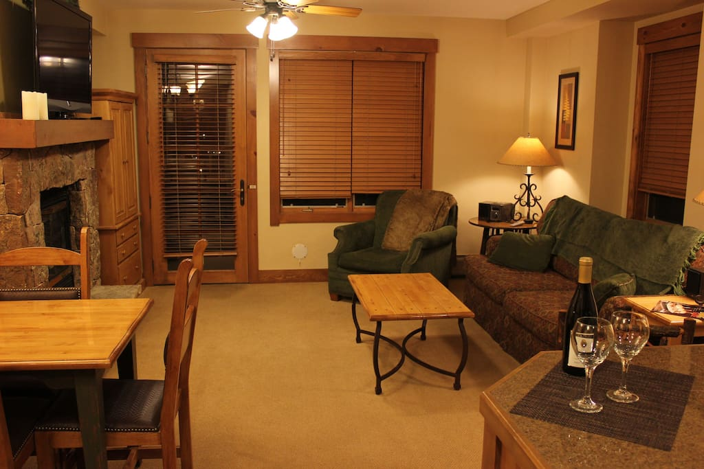 Living Area is Comfortable with a Fireplace and Ceiling Fan