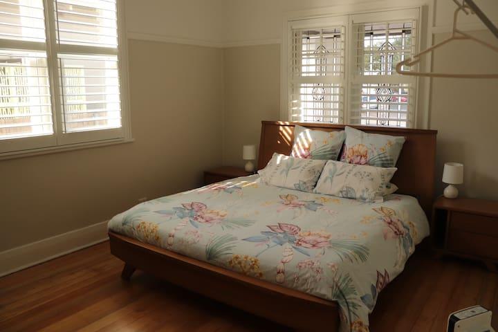 Bedroom 1 - King bed, ceiling fan, heater, desk