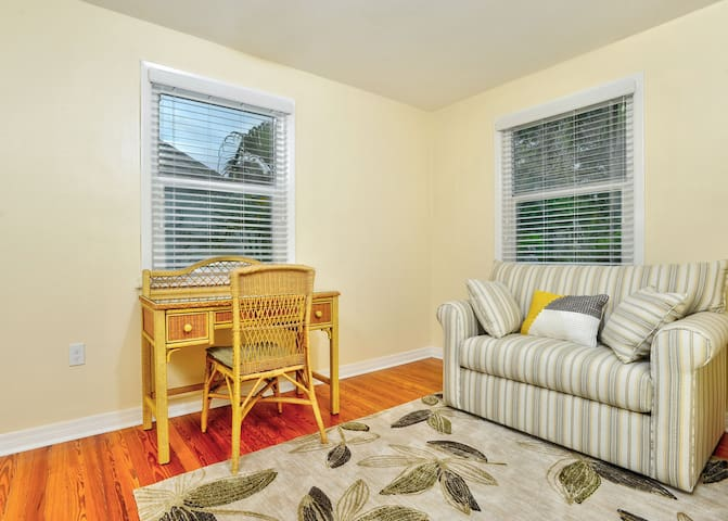 Sunny entry room/den with desk and twin size sleeper sofa can be closed off from other rooms.
