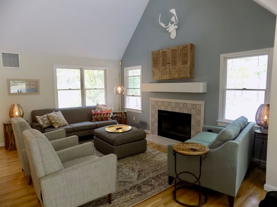 Spacious living room with smart TV and plenty of comfy seating